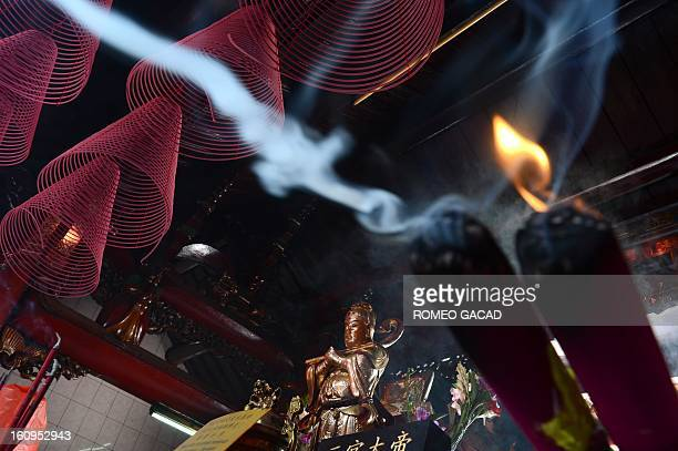 Lighted incense sticks are placed in a Buddhist temple in the Indonesian capital city of Jakarta on February 8 2013 as the Muslim majority country's...