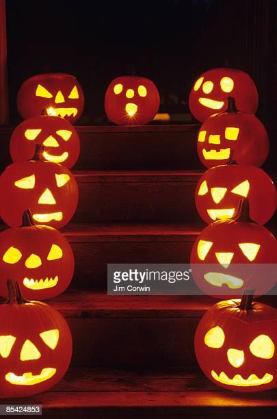 Lighted pumpkins on house steps