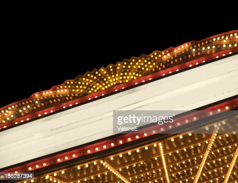 Lighted theater marquee at night with copy space