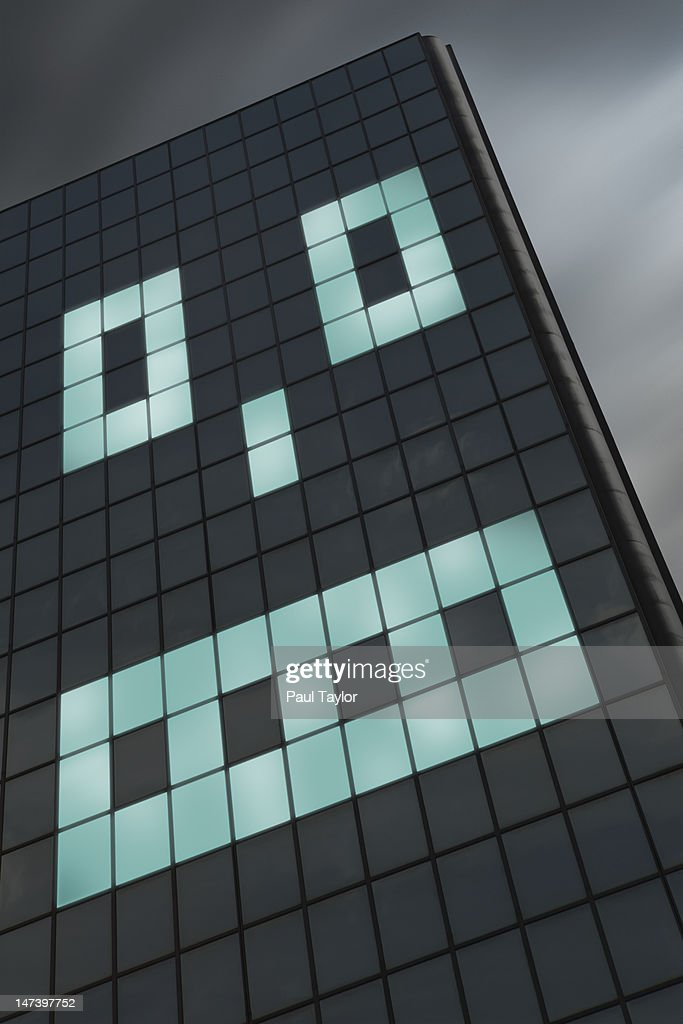 Lighted Windows in Shape of Face : Stock Photo