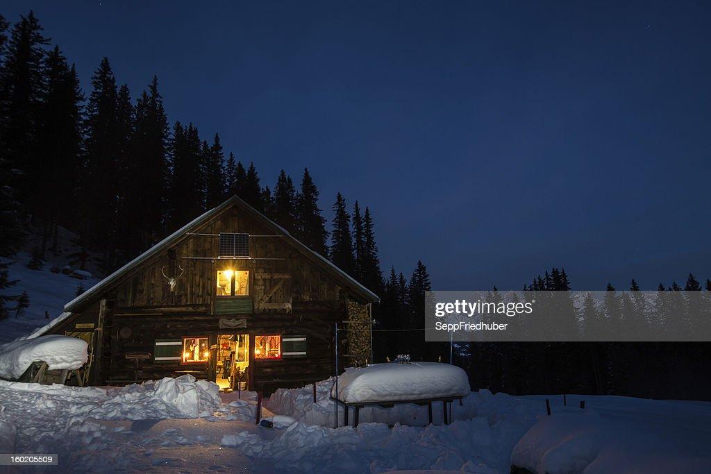 Lightened mountain hut in the austrian alps