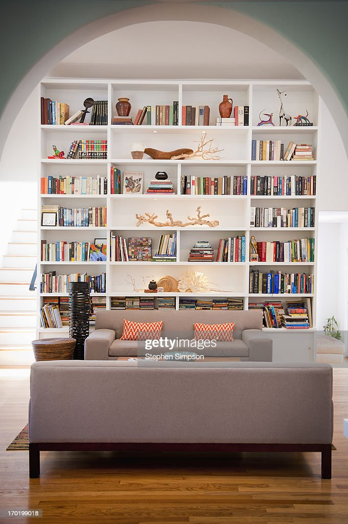 light-filled living room with tall bookshelves : Stock Photo