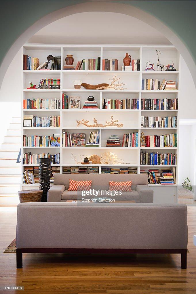 light-filled living room with tall bookshelves