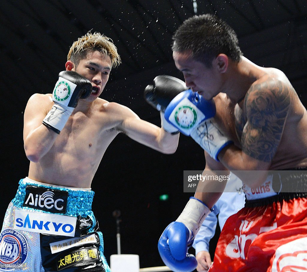 WBA lightflyweight champion Kazuto Ioka (L) of Japan lands a left hook on Thai challenger Wisanu Kokietgym at the title bout in Osaka on May 8, 2013. Ioka retained his belt by a knokout in the nineth round.