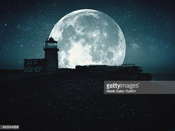 Lighthouse Against Majestic Moon