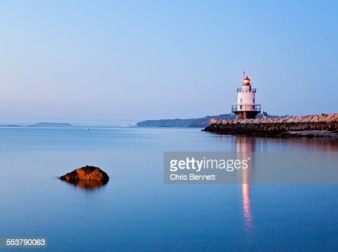 A lighthouse along the Maine coast at twighlight.