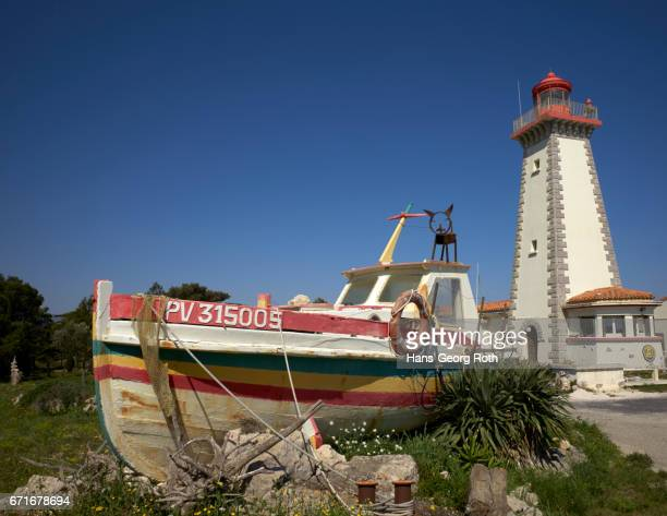 Lighthouse and old fishing boat at Cape Leucate