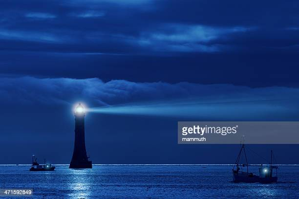 lighthouse and ships in the night