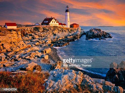 A lighthouse and shoreline on the coast of Maine, USA