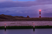 Red and white lighthouse in the evening. Nieuwpoort, Flanders, Belgium
