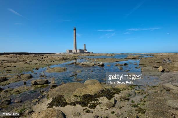 Lighthouse at Pointe de Barfleur at low tide