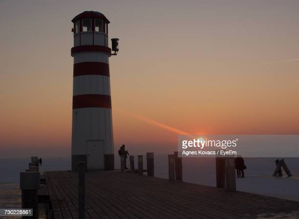 Lighthouse At Seaside During Sunset
