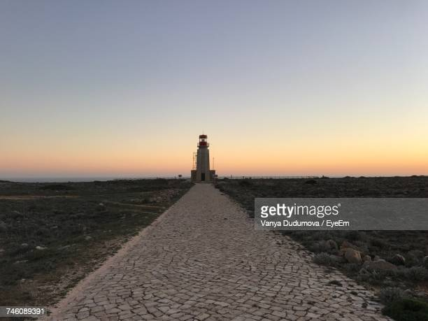 Lighthouse By Sea Against Clear Sky During Sunset At Sagres