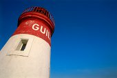 Lighthouse in blue sky