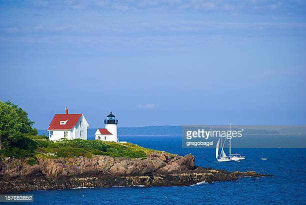 Lighthouse in Camden, Maine with sailboat