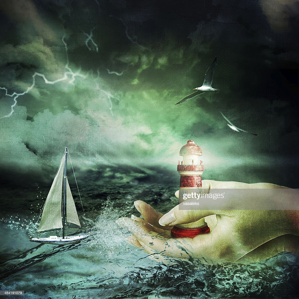 Lighthouse in the hands : Stock Photo