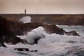 Lighthouse on the far West of the island receiving the full force of the Atlantic with 11 meter waves hitting the 100ft cliffs behind West Town Tory...