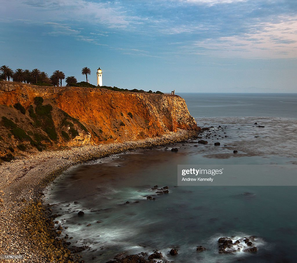 Lighthouse shines on cliff