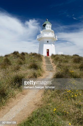 Lighthouse with path and stairs at Waipapa Point, Otara, Fortrose, Southland Region, South Island, New Zealand