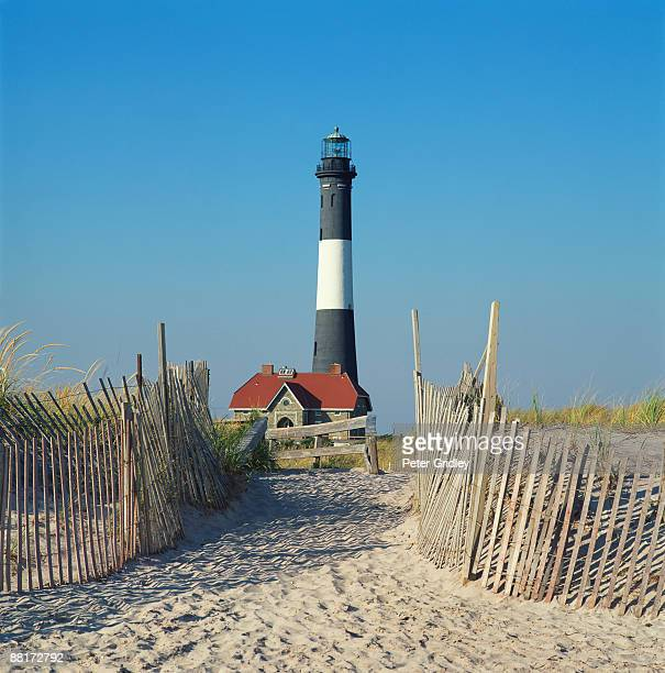 Lighthouse with sand path