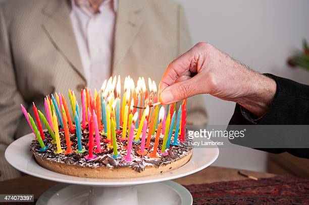 Lighting 93 candles on a cake