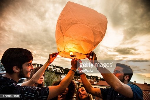 Lighting a chinese lantern at birthday party