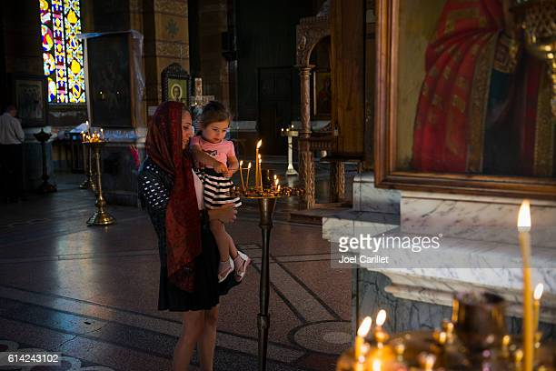 Lighting candles at Georgian Orthodox church in Batumi
