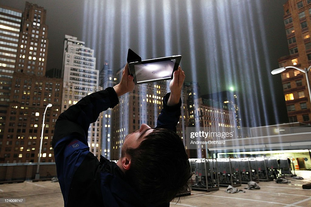 Lighting Designer Frank Hollenkamp uses his iPad to shoot video of the Tribute in Lights ahead of the tenth anniversary of the September 11 terrorist attacks on September 7, 2011 in New York City. The Tribute in Light is comprised of 88 1-degree beams of 7000 watt searchlights focused into the sky near the site of the World Trade Center in remembrance of the September 11 attacks.