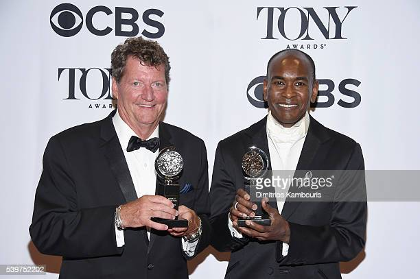 Lighting designer Howell Binkley and costume designer Paul Tazewell pose with awards during the 70th Annual Tony Awards at The Beacon Theatre on June...