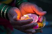 Lighting diyas as offerings to the Ganga River, Varanasi, India.