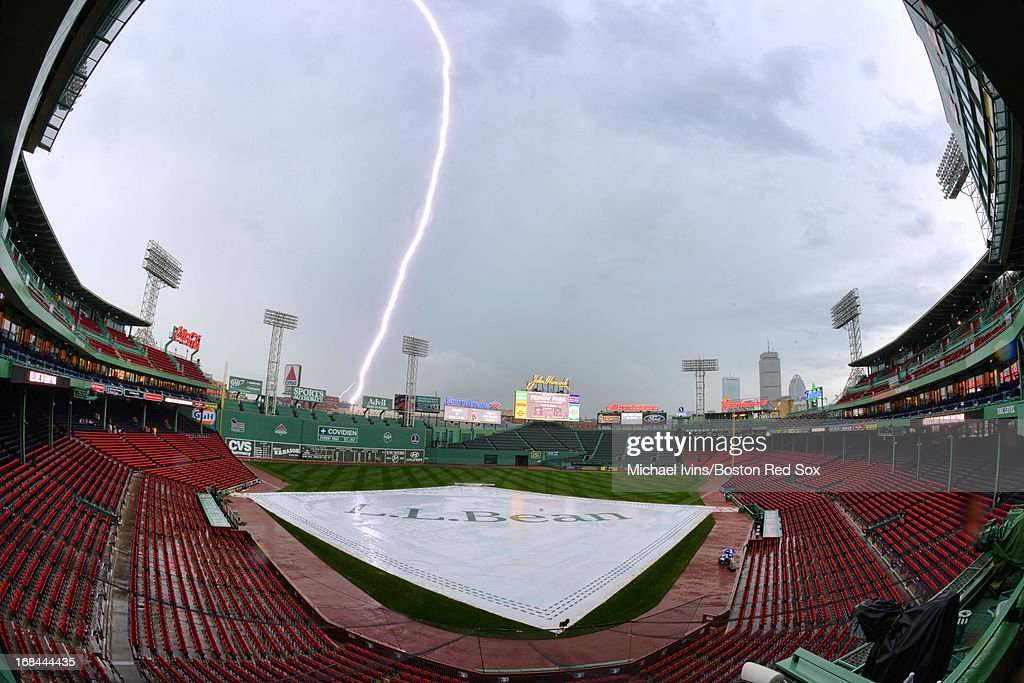 Lighting strikes near Fenway Park before the start of a game between the Boston Red Sox and the Minnesota Twins on May 9, 2013 in Boston, Massachusetts.