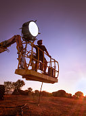 lighting technician, placing the light during a film