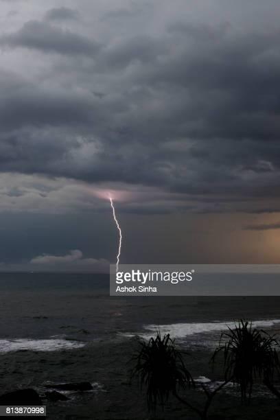 Lightning bolt flash on the ocean's horizon.