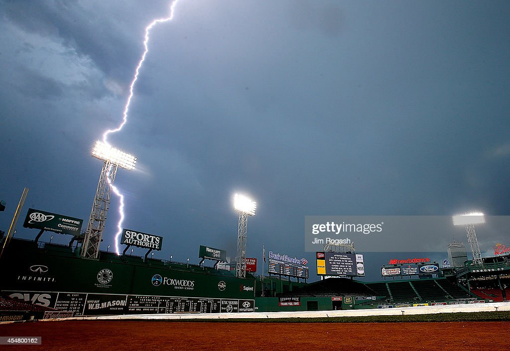 A lightning bolt illuminates the sky near Fenway Park before a game between the Toronto Blue Jays and Boston Red Sox on September 6 2014 in Boston...