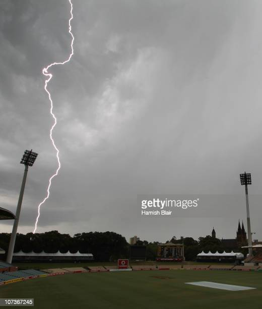 Lightning breaks behind the field of play as rain and thunderstorms hit the ground a few hours after the end of the match after day five of the...
