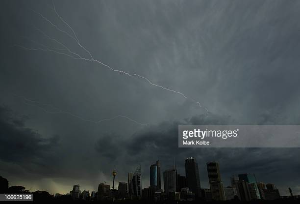 Lightning flashes across the sky over the Sydney central business district as severe thunderstorms hit Sydney on November 8 2010 in Sydney Australia