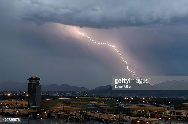 Lightning flashes east of Black Mountain during a thunderstorm on July 6 2015 in Las Vegas Nevada The monsoon storm dropped heavy rain and hail in...