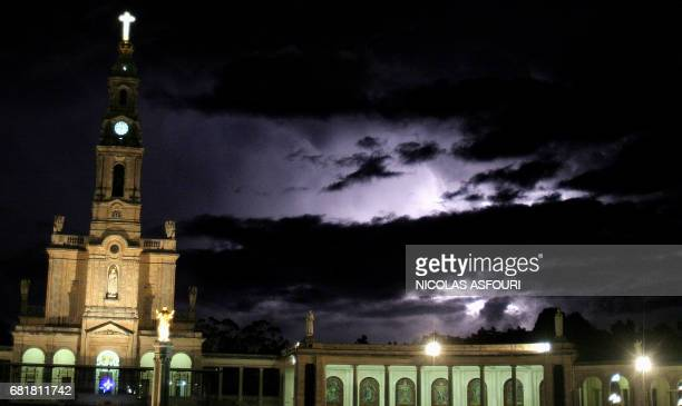 Lightning flashes in the stormy sky as mass and prayers continue at the Basilic of Fatima 140 kilometers north of Lisbon 01 Avril 2005 Pope John Paul...