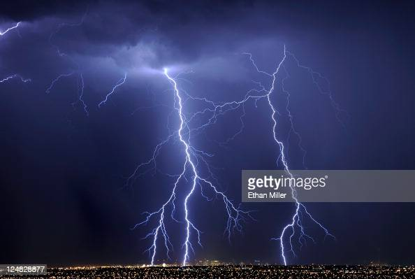 Lightning flashes over hotelcasinos in downtown Las Vegas during a thunderstorm early on September 13 2011 in Las Vegas Nevada Stormy weather is...