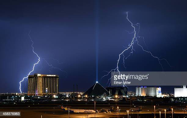 Lightning flashes west of the Mandalay Bay Resort and Casino the Luxor Hotel and Casino and the Excalibur Hotel Casino on the Las Vegas Strip on July...