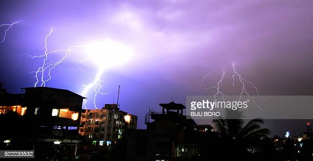 Lightning illuminates the night sky during a storm over Guwahati on April 18 2016 Much of India is suffering from extreme drought conditions however...