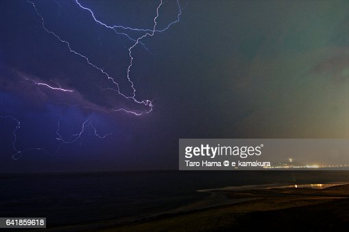 Lightning on the night beach
