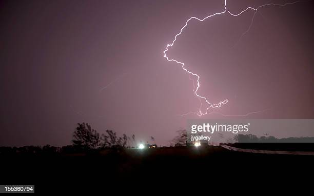 Lightning  over farm and road