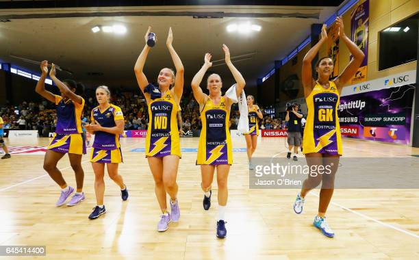 Lightning players celebrate their win during the round two Super Netball match between the Queensland Firebirds and the Melbourne Vixens at...
