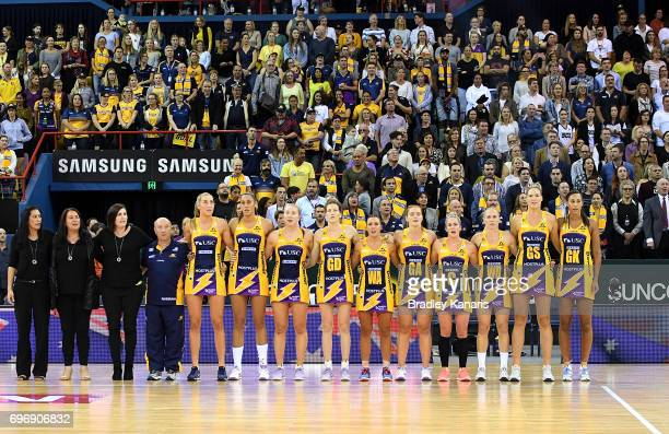 Lightning players embrace for the national anthem before the Super Netball Grand Final match between the Lightning and the Giants at the Brisbane...