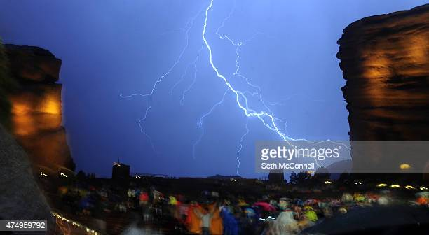 Lightning streaks across the sky during a weather delay at Red Rocks Amphitheatre in Morrison Colorado on May 27 2015