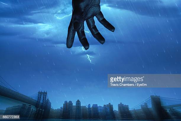 Lightning Strike Above Built Structures With View Of Hand