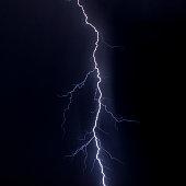 Lightning strike over night city