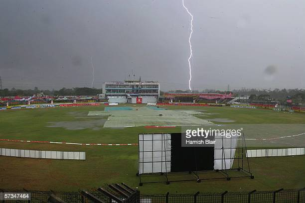 Lightning strikes behind the ground during a storm that delayed play during day two of the Second Test between Bangladesh and Australia played at the...