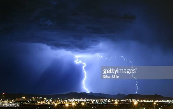 Lightning strikes during a thunderstorm on July 6 2015 in Las Vegas Nevada The monsoon storm dropped heavy rain and hail in parts of the valley...
